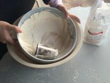 sifting flour for pitas